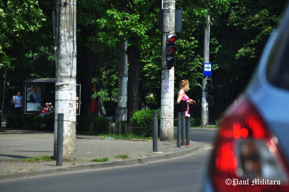 a blonde at traffic lights