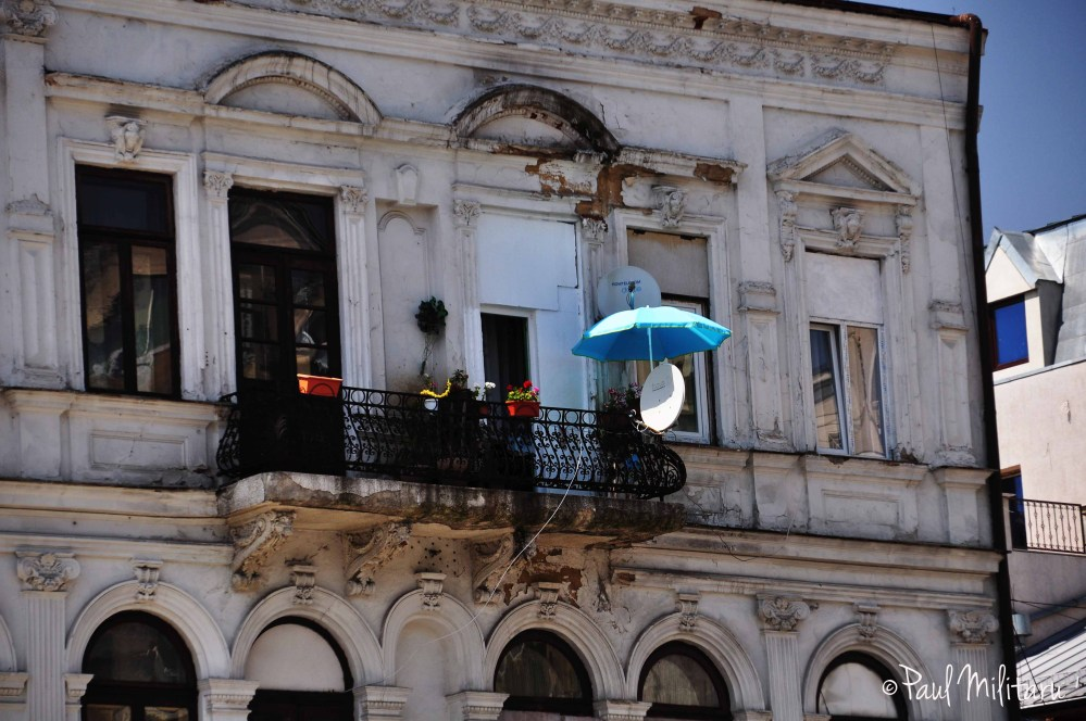 an old house and a blue umbrella