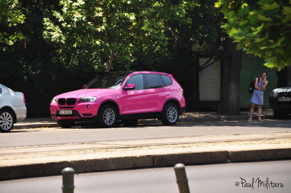 she, a phone and a pink bmw