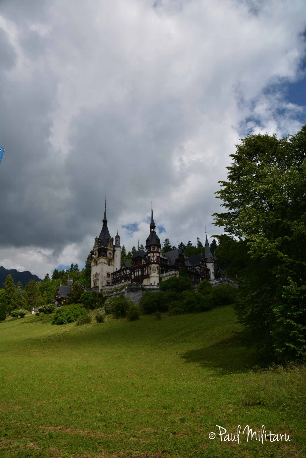 storm clouds above Peles Castle