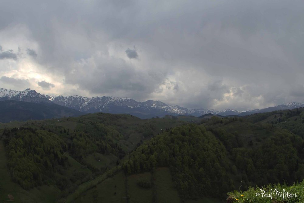 storm clouds in snowy mountains