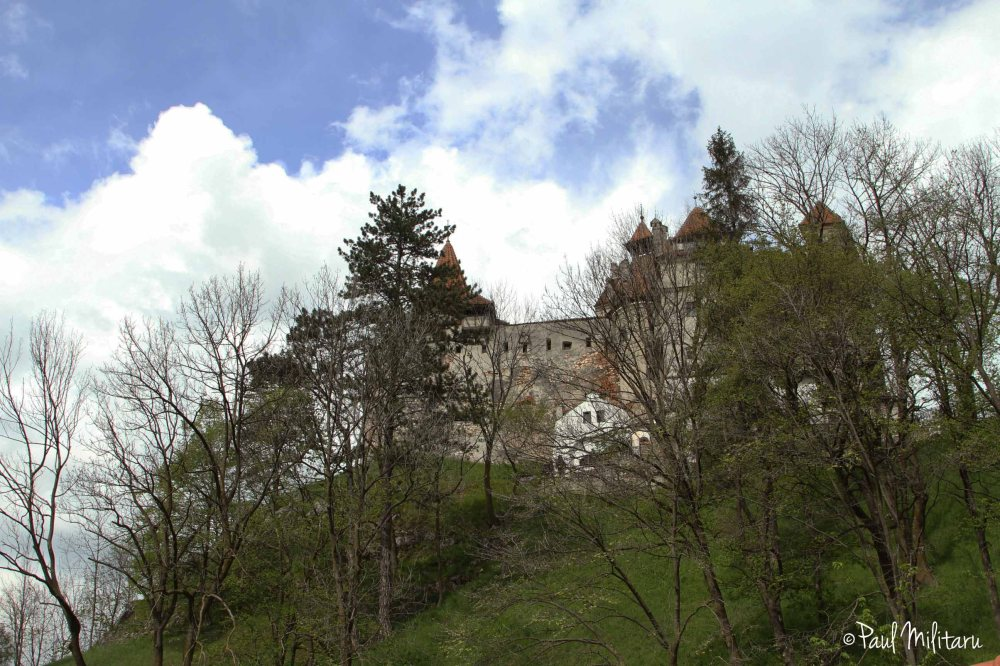 bran castle under the clouds